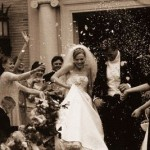 Wedding Party Throwing Rice at Newlyweds
